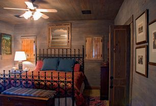 Rustic Guest Bedroom with Grace - gothic wrought iron bed, French doors, Ceiling fan, slate floors