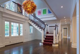 Contemporary Entryway with Columns, Crown molding, Carpeted steps, Wainscotting, Chandelier, Loft, Cathedral ceiling, Paint