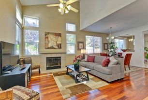 Contemporary Living Room with Fireplace, stone fireplace, picture window, High ceiling, Hardwood floors, Ceiling fan