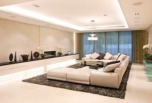 Modern Living Room with Pendant light, sandstone tile floors, interior wallpaper