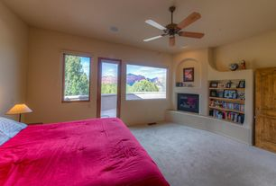 Mediterranean Master Bedroom with French doors, Ceiling fan, Carpet, specialty door, Built-in bookshelf