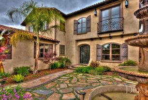 Mediterranean Landscape/Yard with Fountain, exterior stone floors, Pathway, Casement, Bird bath, French doors, Arched window