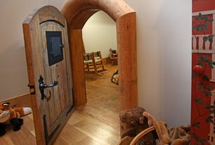 Rustic Playroom with specialty door, Melissa and doug basset hound plush, Paint 1, Hardwood floors, Standard height