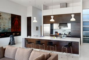 Contemporary Kitchen with Waterfall countertop, full backsplash, One-wall, Dupont Corian Designer White, gas range, Flush