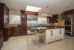 Traditional Kitchen with Pendant light, Flat panel cabinets, limestone tile floors, flush light, Soapstone counters, U-shaped