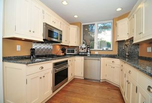 Traditional Kitchen with Dynasty hardware - shaker style cabinet pull, Simple granite counters, Casement, dishwasher, Paint