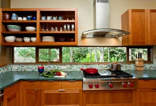 Craftsman Kitchen with Long tab pull, Casement, dishwasher, Ceramic Tile, Wall Hood, European Cabinets, Laminate countertops