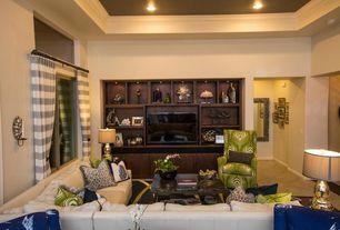 Traditional Living Room with Built-in bookshelf, sandstone tile floors