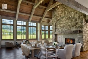 Rustic Great Room with flush light, Wall sconce, stone fireplace, Chandelier, Hardwood floors, Fireplace, Exposed beam