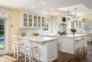 Traditional Kitchen with Subway Tile, Standard height, Breakfast bar, electric cooktop, French doors, full backsplash, Paint