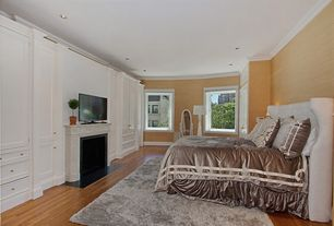 Traditional Master Bedroom with Crown molding, Standard height, Casement, can lights, Built-in bookshelf, Hardwood floors