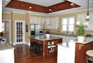 Traditional Kitchen with Complex Granite, specialty door, U-shaped, Flush, Crown molding, Breakfast bar, Kitchen island