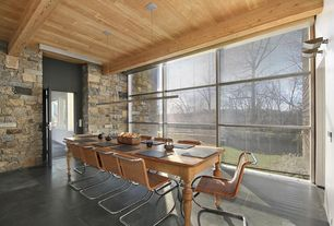 Contemporary Dining Room with Concrete floors, Pendant light, Exposed beam, High ceiling