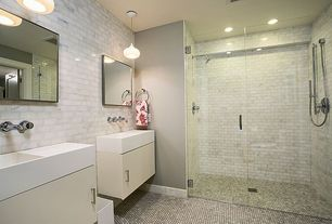 Contemporary 3/4 Bathroom with specialty door, Pendant light, frameless showerdoor, Handheld showerhead, European Cabinets