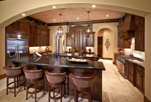 Mediterranean Kitchen with Raised panel, Crown molding, Custom hood, Uttermost micayla wall panel set, wall oven, can lights