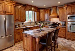 Craftsman Kitchen with Raised panel, Osborne Wood Island Legs, Custom hood, Kitchen island, limestone tile floors, Flush
