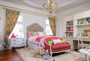 Traditional Kids Bedroom with Laminate floors, Frontgate Astor Tufted Upholstered Bed, Chandelier, Vintage settee, Shag rug
