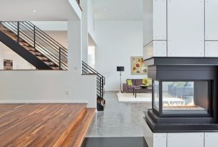 Contemporary Living Room with complex marble floors, High ceiling, Fireplace, can lights, insert fireplace