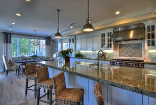 Traditional Kitchen with Breakfast bar, Flat panel cabinets, Undermount sink, One-wall, Chandelier, Crown molding