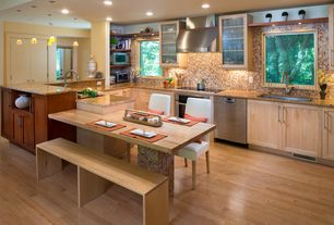 Craftsman Kitchen with European Cabinets, U-shaped, American Olean Visionarie Warm Sunset Glass Mosaic, Glass panel, Flush