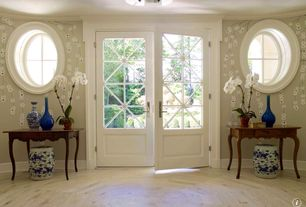 Traditional Entryway with specialty window, Hardwood floors, French doors, interior wallpaper, Standard height, flush light