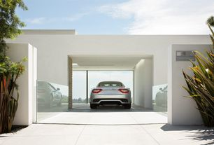 Contemporary Garage with Concrete tile , Glass wall