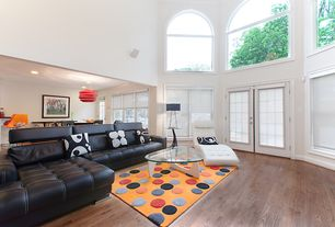 Modern Living Room with French doors, Hardwood floors, Arched window, Cathedral ceiling