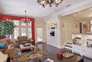 Traditional Living Room with French doors, Laminate floors, Carpet, Crown molding, Paris Linen Ottoman, Chandelier
