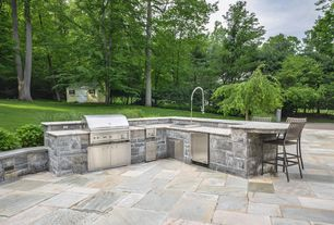 Traditional Patio with Pathway, exterior stone floors, Outdoor kitchen