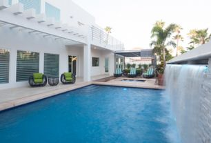Contemporary Swimming Pool with Gazebo, Trellis, Fence, exterior stone floors, Raised beds, Pool with hot tub, French doors