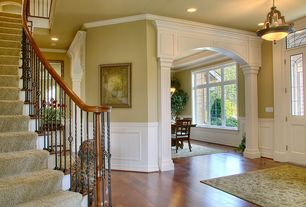Traditional Entryway with specialty door, Crown molding, Hardwood floors, Columns, can lights, flush light, Wainscotting