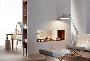 Contemporary Living Room with Concrete floors, High ceiling, Built-in bookshelf, Adesso Atlas Floor Lamp, Barcelona chair