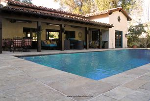 Mediterranean Swimming Pool with Pathway, Lap pool, French doors, Fence, exterior stone floors