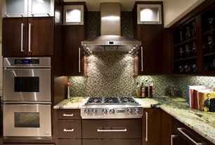 Modern Kitchen with Jenn air gas cooktop, Framed Partial Panel, Standard height, Granite countertop, Glass panel, Wall Hood