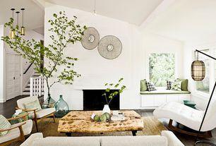 Contemporary Living Room with Hardwood floors, Pendant light, Exposed beam, Window seat, interior brick