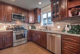 Craftsman Kitchen with Inset cabinets, Simple granite counters, Glass panel, Limestone Tile, Raised panel, Stone Tile