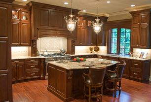 Traditional Kitchen with Complex granite counters, Savoy House Bell Foyer Lantern, Chesterfield Counter Height Bar Stoo