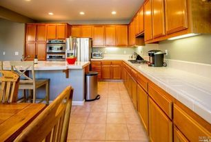 Traditional Kitchen with Raised panel, L-shaped, Limestone tile counters, Custom hood, Large Ceramic Tile, Breakfast nook
