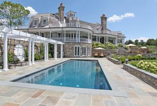 Traditional Swimming Pool with double-hung window, Deck Railing, French doors, Outdoor kitchen, Pathway, Raised beds, Trellis