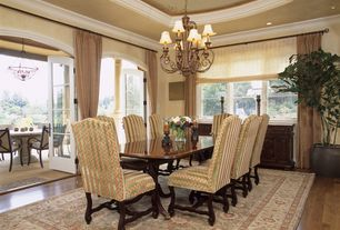 Mediterranean Dining Room with Crown molding, can lights, Chandelier, High ceiling, French doors, double-hung window