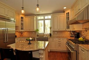 Traditional Kitchen with Glass panel, Kitchen island, Breakfast bar, Stone Tile, Limestone Tile, Flush, Raised panel