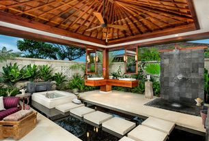 Tropical Master Bathroom with Rain shower, Ceiling fan, Water feature, Custom shower, Wall sconce, Master bathroom