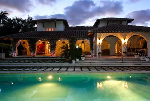 Mediterranean Swimming Pool with Raised beds, exterior stone floors, French doors, Pathway