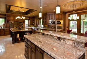 Traditional Kitchen with Kitchen island, Breakfast bar, limestone tile floors, U-shaped, dishwasher, Chandelier, can lights