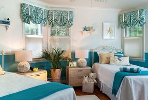 Cottage Guest Bedroom with Ceiling fan, Hardwood floors, Wainscotting, Crown molding