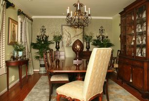 Traditional Dining Room with Crown molding, Hardwood floors, Chandelier, interior wallpaper