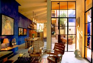 Eclectic Great Room with French doors, Hardwood Dining Chair Clear, High ceiling, Concrete floors, Built-in bookshelf