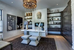 Contemporary Home Office with Standard height, insert fireplace, Casement, Fireplace, Laminate floors, can lights, Chandelier