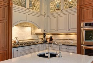 Traditional Kitchen with Raised panel, Glass panel, can lights, Undermount sink, Simple granite counters, Custom hood