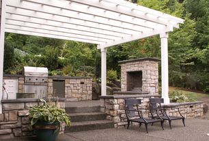 Traditional Patio with Outdoor kitchen, Trellis, Outdoor lounge furniture